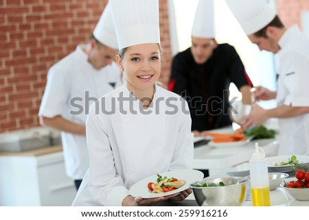 Portrait of student girl in cooking training course - stock photo