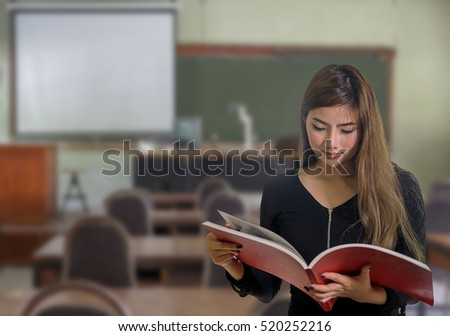 Portrait of student having a test in a classroom