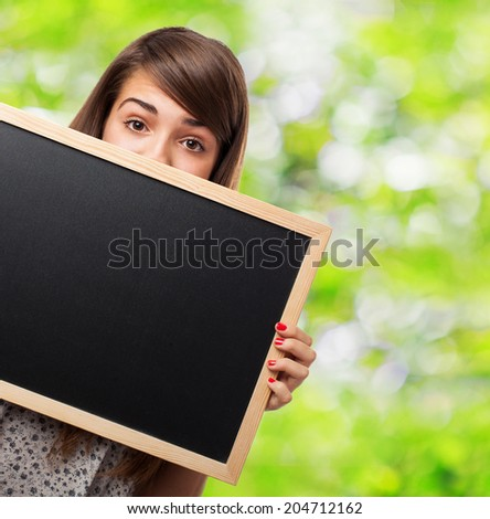 portrait of student hidden behind a chalkboard
