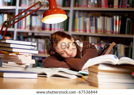 Portrait of student sleeping in university library