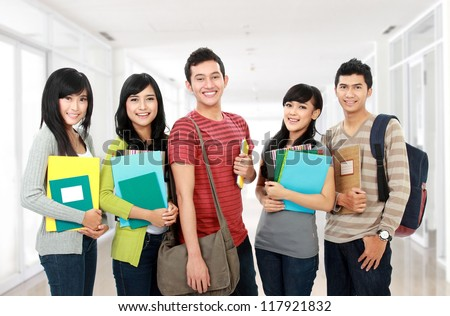 portrait of students holding notebooks at school university - stock photo