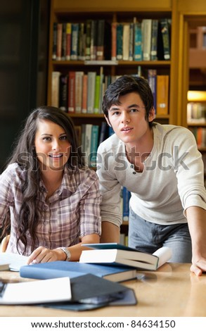 Portrait of students posing in a library - stock photo