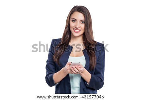 Portrait of stylish beautiful young woman isolated on white background. Woman smiling and using mobile phone - stock photo