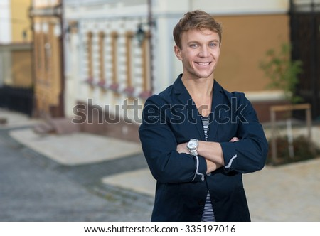 Portrait of stylish fashionable young man walking on the street. Twins outdoor fashion style concept.