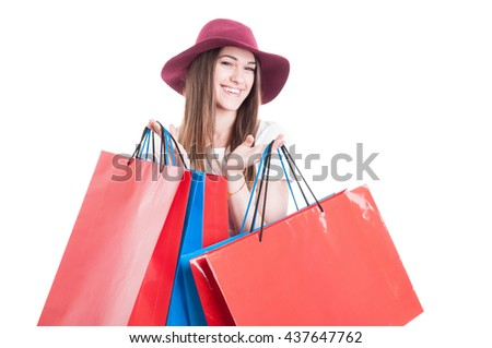 Portrait of stylish shopper holding colorful shopping bags and smiling isolated on white background with copyspace