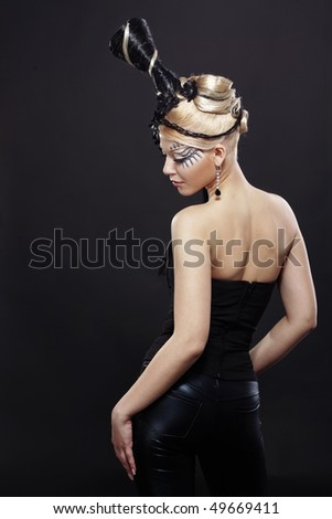 Portrait of stylish woman with fantasy hairstyle and make-up