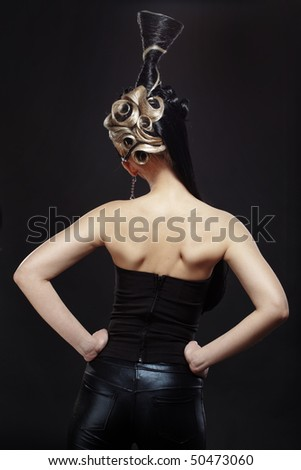 Portrait of stylish woman with fantasy hairstyle back view
