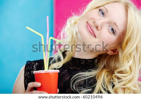 Portrait of stylish woman with soda looking at camera - stock photo
