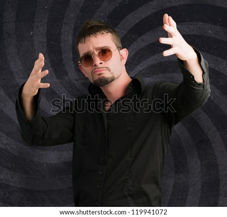 Portrait Of Stylish Young Man against a spiral background