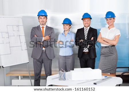 Portrait Of Successful Architects With Arm Crossed Standing Together