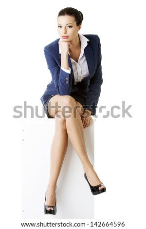 Portrait of successful attractive businesswoman sitting - stock photo