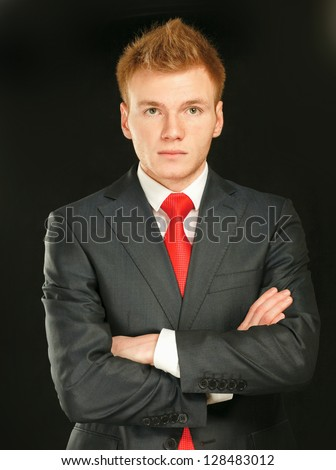 Portrait of successful business man, isolated on black background - stock photo