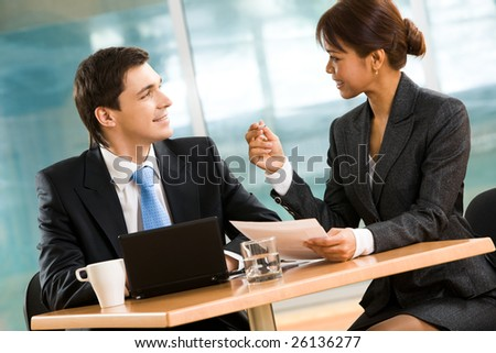 Portrait of successful business partners discussing new plan at meeting - stock photo