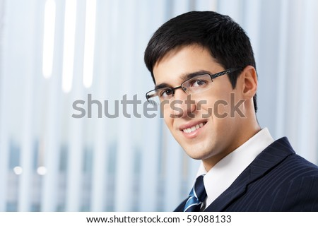 Portrait of successful businessman at office