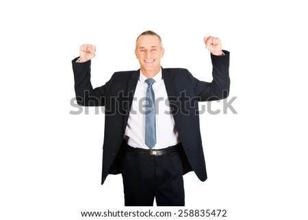 Portrait of successful businessman with arms up. - stock photo