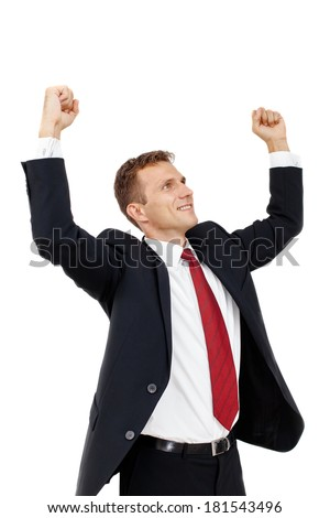 Portrait of Successful businessman with clenched fist and holding arms up. An image of success, victory, a winner. Isolated on white background.