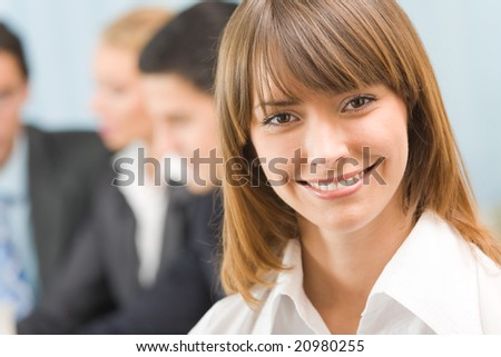 Portrait of successful businesswoman and business-team at office meeting - stock photo