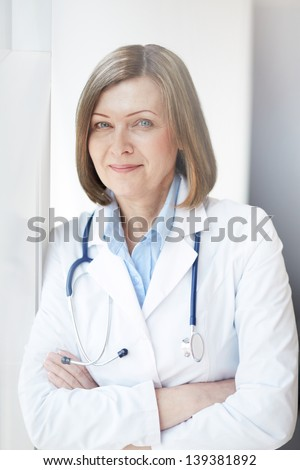 Portrait of successful female practitioner looking at camera - stock photo