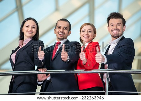 Portrait of successful international business people team. View from below. - stock photo