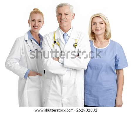 Portrait of successful medical staff standing against white background.