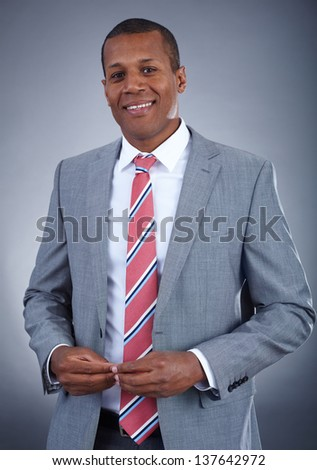 Portrait of successful professional in suit looking at camera - stock photo