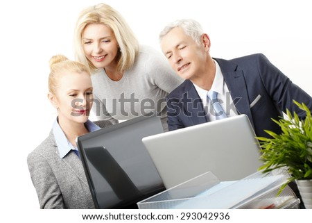 Portrait of successful sales team sitting in front of laptop and analyzing financial data. Isolated on white background.  - stock photo