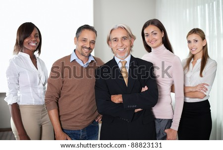 Portrait of successful team of business professionals standing together - stock photo