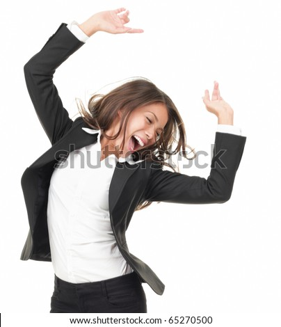 Portrait of successful winner celebrating by dancing. Beautiful young happy woman isolated on white background. - stock photo