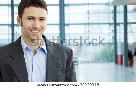 Portrait of successful young businessman at corporate location. - stock photo