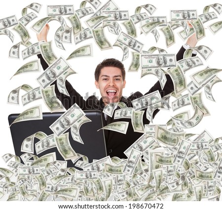 Portrait of successful young businessman with money rain - stock photo