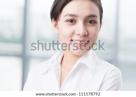 Portrait of successful young businesswoman smiling at camera