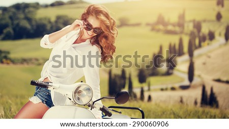 Portrait of summer girl on scooter - Outdoor on Tuscany hiills.Retro shot. Vintage photo - stock photo