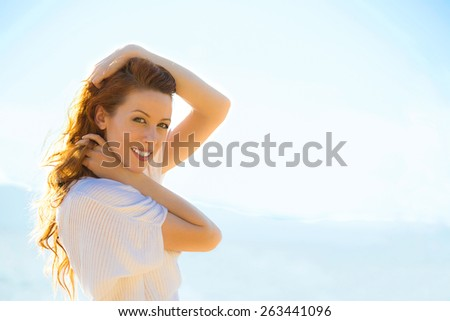 Portrait of summer young woman outdoors. Soft sunny colors. - stock photo