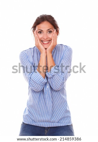 Portrait of surprised adult woman on blue blouse with funny face smiling at you while standing on isolated studio - stock photo