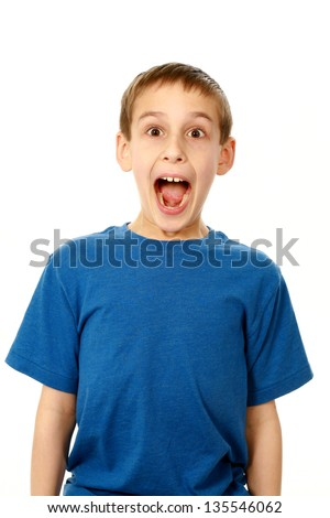 portrait of surprised boy isolated on white - stock photo