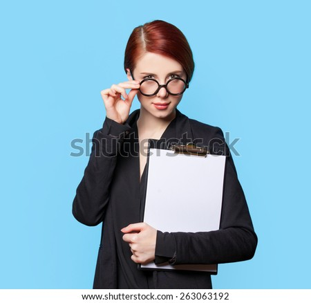 Portrait of surprised business women in glasses on blue background