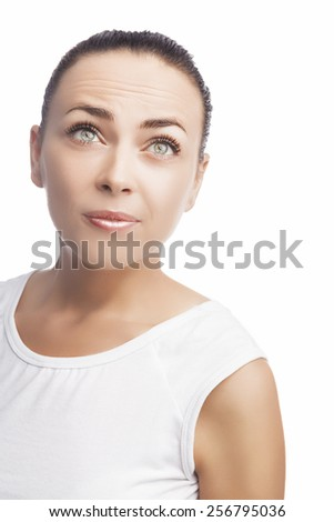 Portrait of Surprised Caucasian Brunette Girl Isolated Over Pure White. Curious Facial Expression. Vertical Shot - stock photo