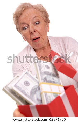 Portrait of surprised female with dollar bills in giftbox looking at it - stock photo