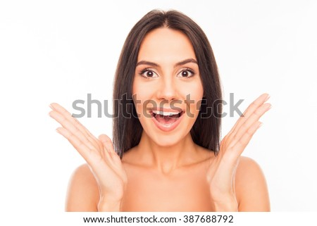 Portrait of surprised pretty woman gesturing with hands