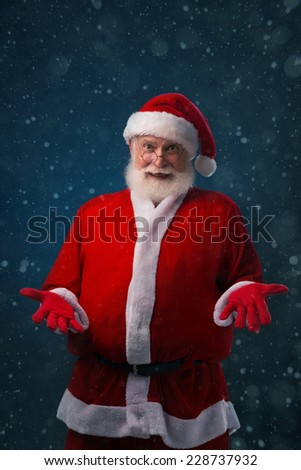 Portrait of surprised Santa Claus looking at the camera - stock photo