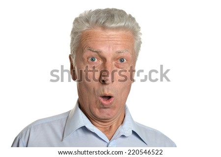 Portrait of surprised senior man on a white background
