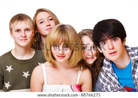 Portrait of surprised teenage friends - stock photo