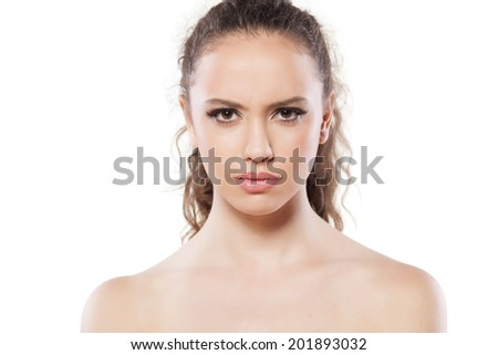 portrait of suspicious young girl on white background - stock photo