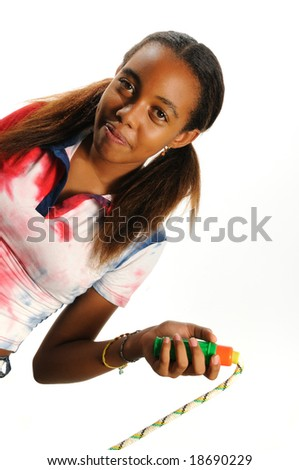 Portrait of sweet african american girl jumping the rope isolated - stock photo
