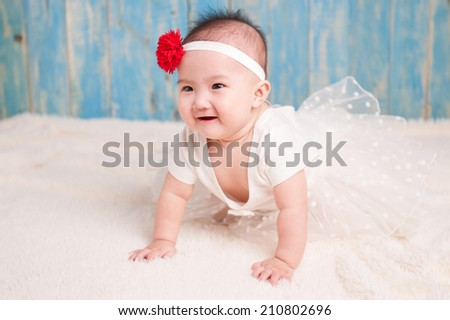 Portrait of sweet baby in white dress - stock photo