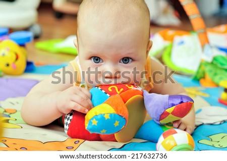 portrait of sweet blue-eyed baby - stock photo