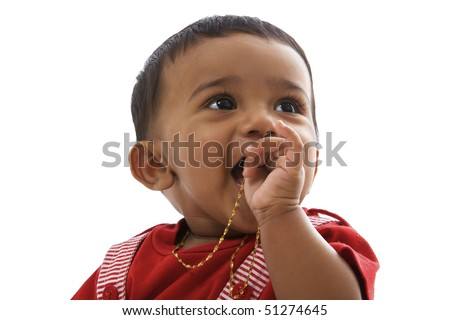 Portrait of sweet indian baby in red clothes looking right. - stock photo