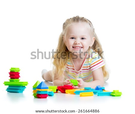 Portrait of sweet kid little girl with toy blocks - stock photo