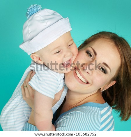 Portrait of sweet little boy and his mother - stock photo