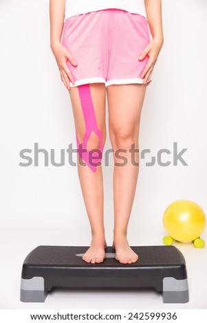 Portrait of taped injured leg - stock photo